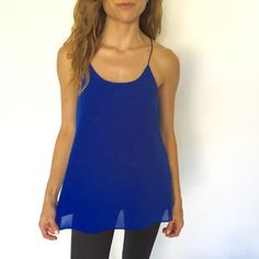 Royal Blue Tank Black straps, royal blue tank. 100% Polyester. No damage, like new. Very cute, flows at the bottom. Looks great for a night out or a lunch date! Naked Zebra Tops Tank Tops