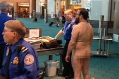 This is RUDE, America!! John E. Brennan stands naked after he stripped down while going through a TSA security screening area at Portland International airport  (July 19,2012)
