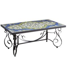 Inspired by traditional Iznik tiles that date back to the 13th century, our handcrafted mosaic Javan table is a pretty accent, whether inside your home or on your patio. Hand-painted tiles form a beautiful mural top while the hand-forged wrought iron scrollwork frame gives it a sturdy and elegant base.