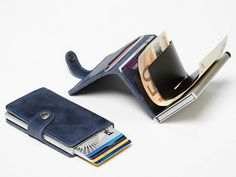The Secrid Mini Wallet is a slim wallet that holds up to 12 cards plus offers RFID protection. GetdatGadget.com/secrid-mini-wallet/