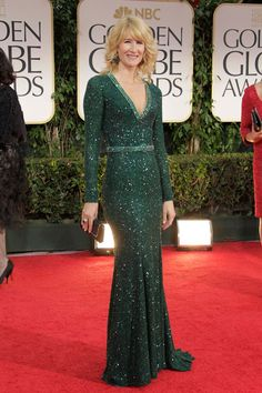 Like the green, the sparkles, the little belt, the long sleeves - great dress