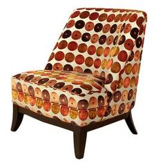 Wood arm chair with chenille upholstery and a retro-style circle motif. Product: ChairConstruction Material: Chenille and woodColor:  Orange and red  Dimensions: 35 H x 29 W x 29 D  Cleaning and Care: Keep furniture out of direct sunlight to avoid sun and light damage and color bleaching.  Clean wood with a soft, dry cloth to remove dust.