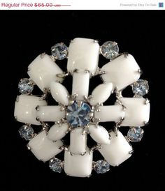 Vintage Milk Glass and Blue Rhinestone Brooch by Vintageimagine on Etsy https://www.etsy.com/listing/182658707/vintage-milk-glass-and-blue-rhinestone