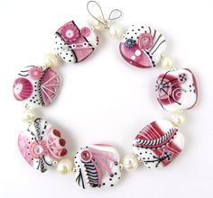 Corinabeads -Lampwork beads by Corina Tettinger. How beautiful are these?