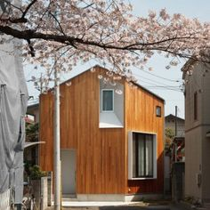 Atelier+Kukka's+House+U+is+designed+to+frame+a+nearby+cherry+tree+in+Tokyo