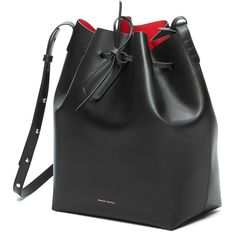"BUCKET BAG FLAMMA 12.25"" H X 10"" W X 6"" D Italian vegetable tanned leather black bucket bag with red interior matte patent. Detachable wallet and adjustable strap. Made in Italy. $595.00"