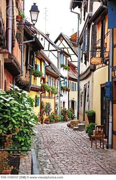 Eguisheim, France - Narrow cobbled streets, beautiful little doors, and all the color fit for a lovely fairytale! Brick Architecture, Beautiful Paris, South Of France, France Travel, Landscape Art, Royalty Free Photos, Places To Go, Europe, Italy