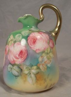 Royal Bayreuth German Handpainted Porcelain Syrup Pitcher decorated with Pink Roses on a muted green ground