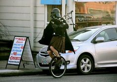 Yes, that is Darth Vader, on a unicycle, in a kilt, playing bagpipes.