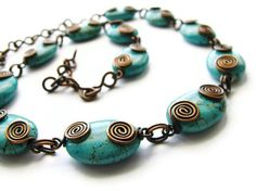 Turquoise Magnesite Necklace with Wire Wrapped Rustic Copper Coils Hand Forged Chain. $64.00, via Etsy.