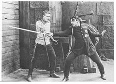 Lewis Stone fencing with Stuart Holmes in The Prisoner of Zenda (1922)