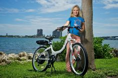 """Check out the pure white gloss version Stride with its powerful motor, which delivers 720 watts at peak, and a high capacity battery. This step-through, rigid frame electric bike brings new meaning to the term """"ease of use. Cycling Girls, Electric Bicycle, Bike, Pure Products, Pure White, Model, Free Shipping, Frame, Check"""