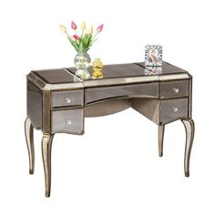 Mirrored writing desk with cabriole legs and an antique gold finish.    Product: Writing desk Construction Material: W...