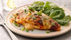 Get dinner on the table fast with these easy, cheesy Mexican stuffed chicken breasts.