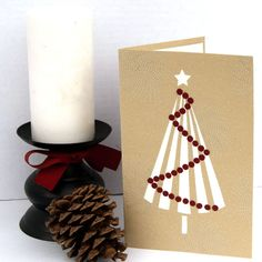 Simple andmade Christmas card featuring a Christmas Tree and ornaments.
