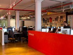 The Behance office is done in classic Soho startup style. Wood floors, high ceilings, and some red piping. Startup Office, Office Space Design, Office Spaces, Vinyl Quotes, Business Articles, Red Walls, Coworking Space, Modern Industrial, Starting A Business