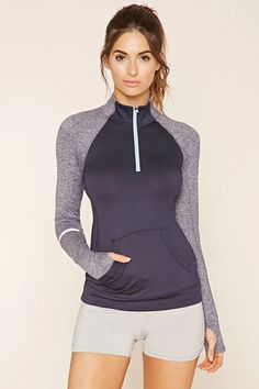 A knit athletic jacket featuring reflective strips on the forearm, long heathered sleeves, a mock neck, kangaroo pocket, and a zip front. Sport Fashion, Fitness Fashion, Fitness Gear, Sporty Outfits, Girl Outfits, Athletic Wear, Active Wear For Women, Casual Summer, Editorial Fashion
