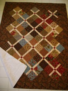 """Snippets of a Quilter: 2 Charm Packs; I didn't use a pattern but simply used a 1 1/2"""" sashing and set the blocks on point."""