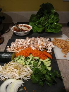 asian chicken lettuce wraps with thai peanut sauce. the chicken is made in the crockpot!
