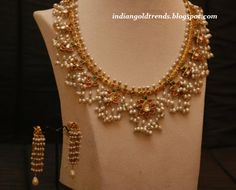 Latest Indian Gold and Diamond Jewellery Designs: Designer antique gold Pearl necklace with pearl ear hangings