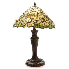 This Warehouse of Tiffany's Sunflower Inpsired Classical Table Lamp features a bright design with unique patterns illuminating the room in style. This gorgeous artisan piece features a steel fixture finish.