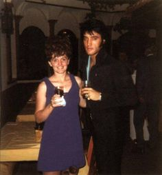 Elvis Presley photographed with a fan at Nancy Sinatra's Opening Show post-party at the International Hotel in Las Vegas, NV on Friday, August 29, 1969.