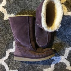 Purple Ugg Boots 8 Amazing condition. No holes no stains. The right boot is a little faded compared to the left but only upon close inspection. UGG Shoes Winter & Rain Boots