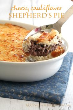Traditional Shepherd's Pie gets a low carb makeover with some mashed cauliflower and cheddar cheese. Comfort food at its finest! Comfort food alert! Comfort food alert! It's quickly getting to that time of year when we all crave soups and stews and meatloaf. Some parts of the world (mine) are already well underway in comfort food season. And as far as I am concerned, shepherd's pie fits well within the definition of comfort. It's meat and potatoes, man! Except that it's no...