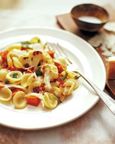 Used Trader Joe's diced pancetta instead of bacon.  Pasta with Roasted Vegetables and Bacon - Martha Stewart Recipes