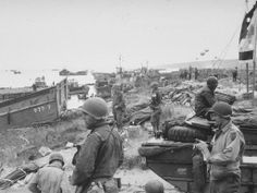 American troops stand by with stores on Omaha Beach after the D-day landings Scottish meteorologist Group Captain James Stagg was appointed chief meteorological adviser to Eisenhower and persuaded him to delay the launch to allow for better weather. This decision saved the lives of thousands of soldiers although rough seas still hampered landings and the RAF struggled to bomb German fortifications through cloud cover.