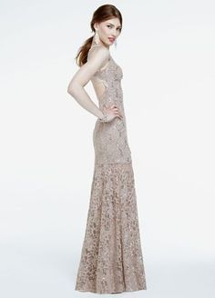 You will draw eye-catching appeal in this ultra-feminine lace gown!  Sleeveless…