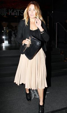 How to Get Lauren Conrad's Signature Style: Try Out Trends.  Pleated skirt, studded booties balanced by classic black on top