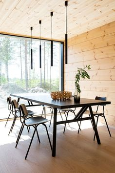 Markki - dining area with black table and chairs