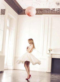 Clémence Poésy with a pink balloon