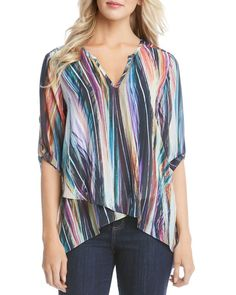 A flowing fit and an asymmetric faux wrap front lend breezy ease to this wear-with-everything roll-sleeve top from Karen Kane, while a multicolor, modern art abstract print offers a bit of pop. | Poly