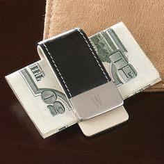 Leather Money Clip...Genuine black leather money clip with silver tone tips. Good for guy giftS