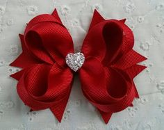 Red Boutique Hair Bow - Girls Hair Bow - Toddler Hair Bow - Christmas Hair Bow - Holiday Hair Bow - Formal Wedding Bow with Sparkly Heart  This Red Boutique Hair Bow with Sparkly Heart is very unique and carries a distinctive elegance and delicate charm. It is the perfect hair accessory for a wedding, party or any formal event. Your adorable little princesses will definitely look very endearing. They will love this as it is a fun and cute color. Add this to your collection of boutique bows…