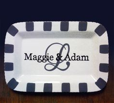 First names and initial painted on rim platter.