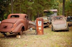Old rusting cars and gas pump speak of history and everyday life from the past.