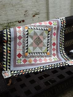 Beautiful medallion quilt. There is just enough going on. One thing I would change is to put it on point somewhere in the process.............and maybe some applique.