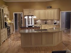 "Hardwood floors, ""miles"" of granite, stainless appliances, etc."