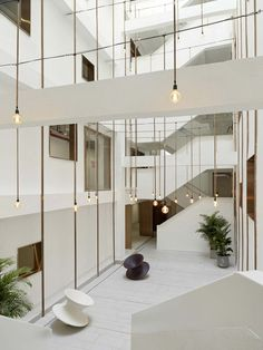Image 4 of 46 from gallery of The Urban Village / TEAM_BLDG. Photograph by Jonathan Leijonhufvud Apartment Renovation, Apartment Plans, Urban Village, Terrazzo Flooring, Facade Design, Types Of Houses, Atrium, House Front, Building A House