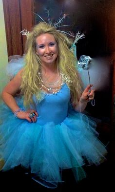 The tutu is made with 12 yards of tuille and 14 strands of (hand-sewn) Chinese crystals. The dress is just stretchy jersey material and is basically a long tank top. She wore robin blue tights. The silver tulip is her magic wand.