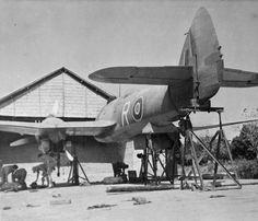 Bristol Beaufighter Mark VIF, 'R', of No. 27 Squadron RAF, on trestles at… Ww2 Aircraft, Military Aircraft, Bristol Beaufighter, Ww2 Planes, Vintage Airplanes, Nose Art, Royal Air Force, Model Airplanes, Military Vehicles