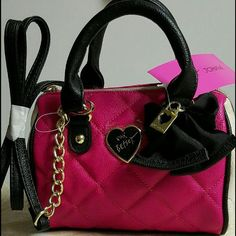 """BETSEY JOHNSON MINI BARREL BAG! Betsey Johnson mini barrel bag. Color is fushia. Approximately 7""""W by 5.75""""H by 4"""" bag depth. 2.5"""" strap with 24"""" removable strap. Brand new, super cute! Betsey Johnson Bags"""