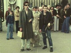 """Shane MacGowan and Shanne Bradley, members of The Nipple Erectors/The Nips at the time, taking a sheep for a stroll outside Buckingham Palace, during the early days of the UK punk scene, as seen in stills from """"The Punk Kebab"""" short documentary Palace London, History Of Punk, Pet Sheep, British Punk, The Pogues, 70s Punk, Best Vibrators, Punk Fashion, Vintage Clothing"""