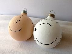 I want to make these ornaments, plus a yellow Woodstock one too! Simply paint them and use black paint (or a black sharpie) to draw the faces!