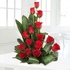 Buy & send The Sweet Surprises online with Ferns N Petals. Order The Sweet Surprises - Basket arrangement of 15 Red Roses. with free shipping in India.