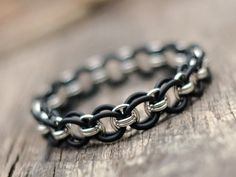 This gorgeous unisex bracelet looks awesome on a guy or girl! The think sterling wire and black jump rings make a classic design that goes with everything. MEMBER - Ahimsa Designs by tidebuyreviews