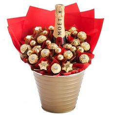 Your gift recipient will be the envy of family and friends with this gorgeous crimson bouquet. A bottle of luxurious Moet and Chandon takes centre stage amidst a red sea of Ferrero Rocher and Belgian milk chocolates. Includes: 750ml bottle of Moet and Chandon champagne, 10 Ferrero Rocher Chocolates, 20 solid Belgian milk chocolate stars from Chocolatier, Keepsake Gold Bucket, Complimentary gift wrapping and gift card.